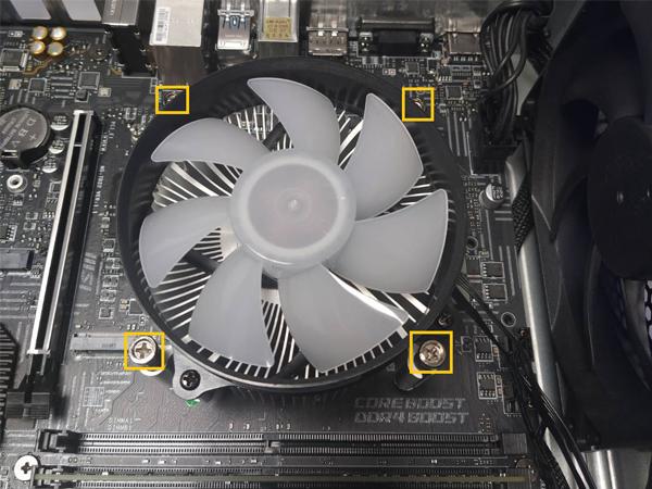 Unscrew 4x screws around CPU cooler