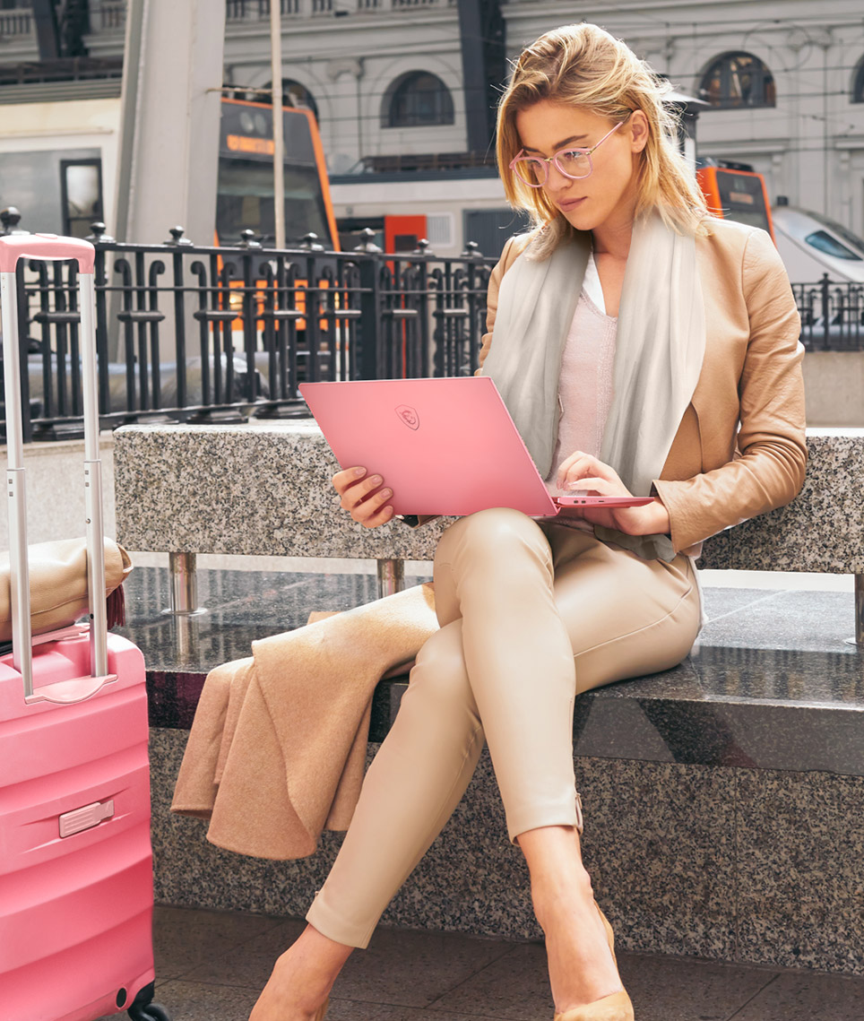 Traveling woman using Prestige 14 ROse Pink.
