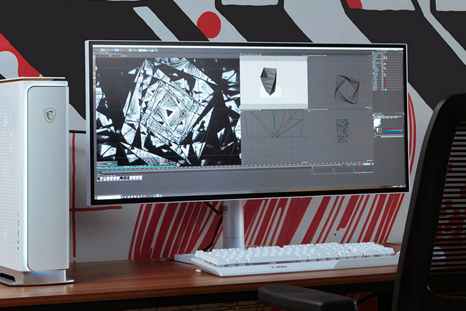 MSI Creation desktop and monitor on a desk.