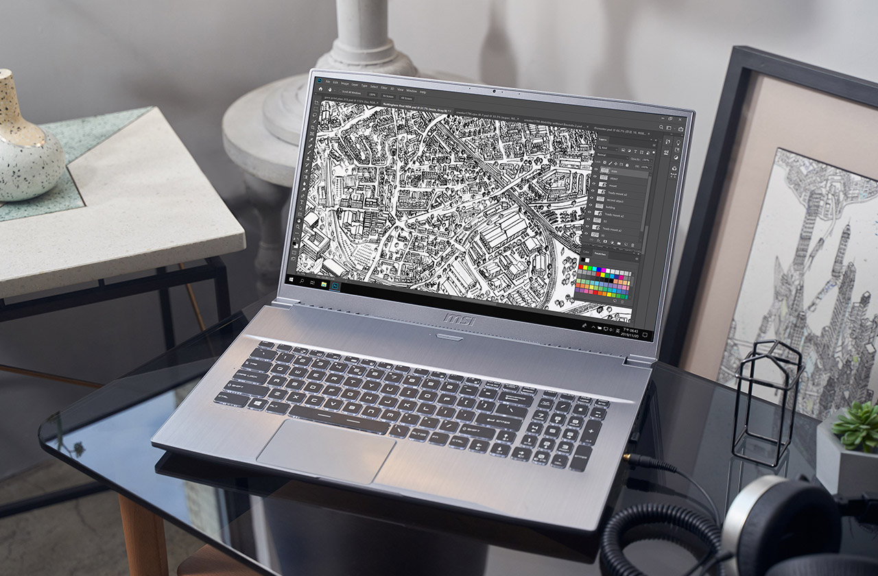 Creator 17 Laptop on table with art doodle.