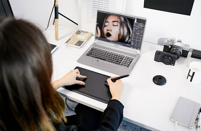 Artist Using Wacom tablet with PS63 .